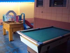 Mesas de jogos e área infantil